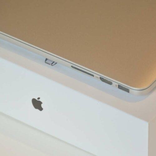 Macbook on a desk.
